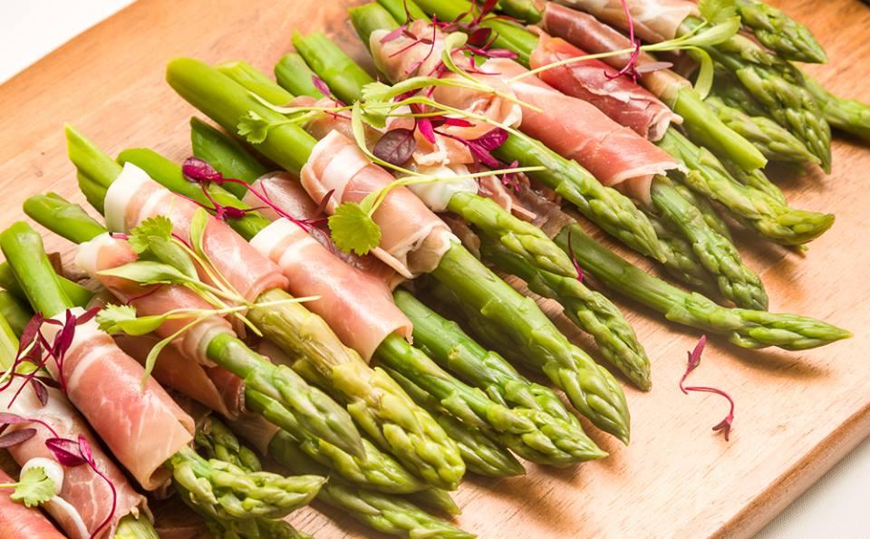 Asparagus wrapped parma ham