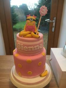 pink and yellow minion 3rd birthday cake