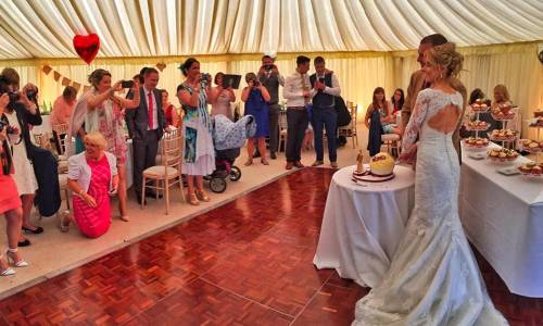 Marquee Wedding with guests and bride and groom