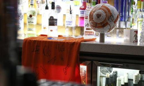Blackpool Football Club Bistro bar with signed football and shirt