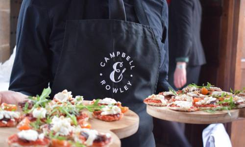 Campbell & Rowley waitress holding canapes